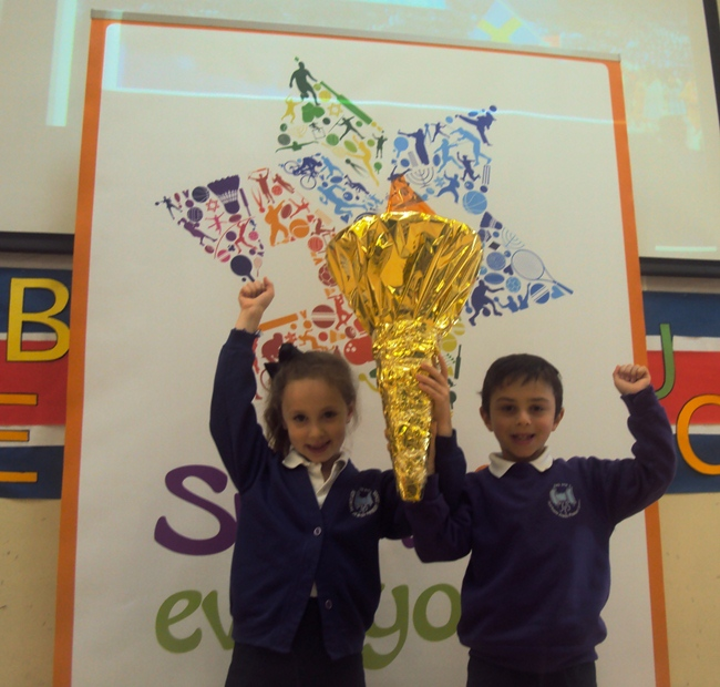 Pupils at HJPS with their Olympic Flame