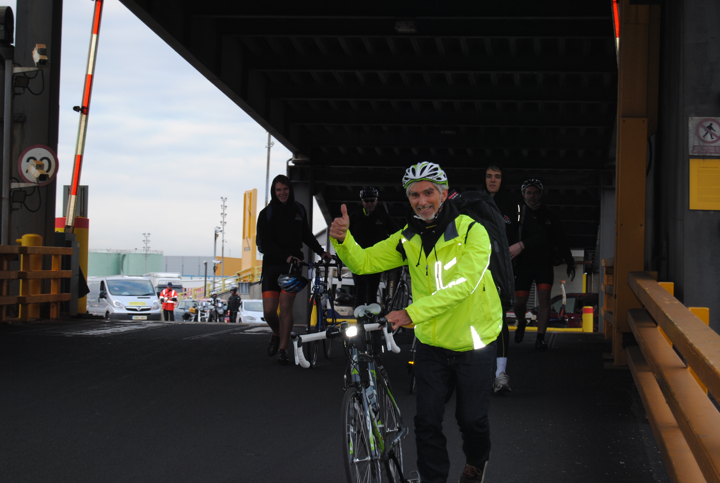Damon Hill waves as he gets on the ferry