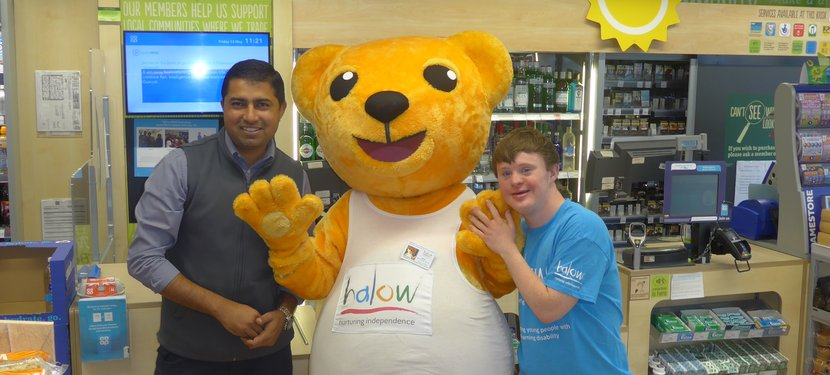 Irfan Hameed, Community Champion for the Co-op and accompanied by Hector and Will Haws