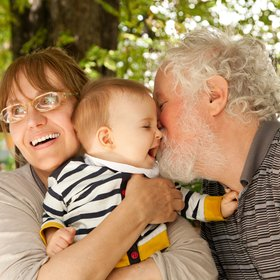 adopting a child advice - older couple with baby