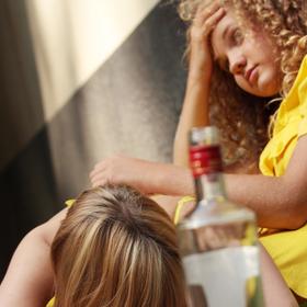 teen drinking vodka