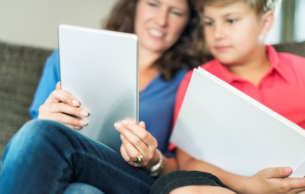 mum and son on laptop