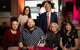 Chief Exec Lisa Wimborne & Chairman John Joseph MBE with tenants Hayley, Kane, Pamela & Family member Tracy