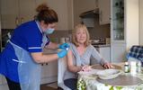 Pamela receiving vaccine.jpg